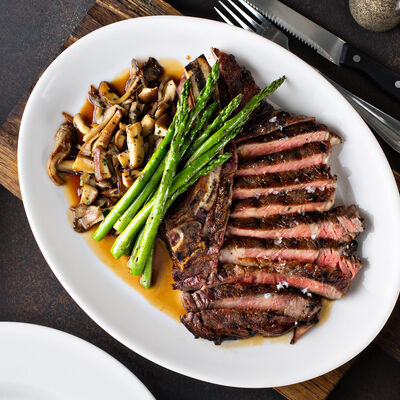 Sirloin Steaks With Mushroom and Leafy Green Sauté