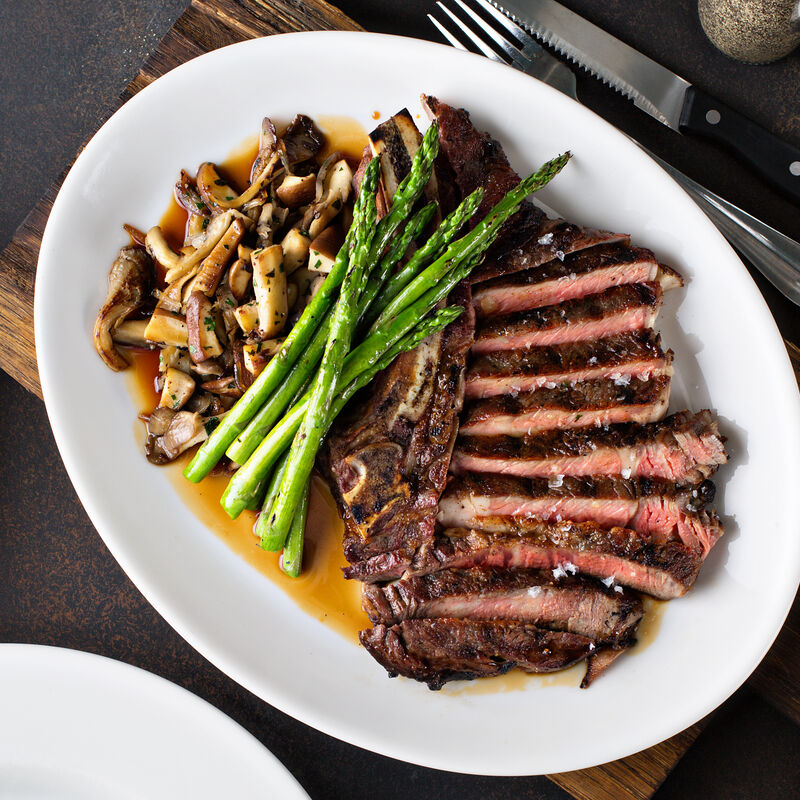 Sirloin Steaks With Mushroom and Leafy Green Sauté image number 0