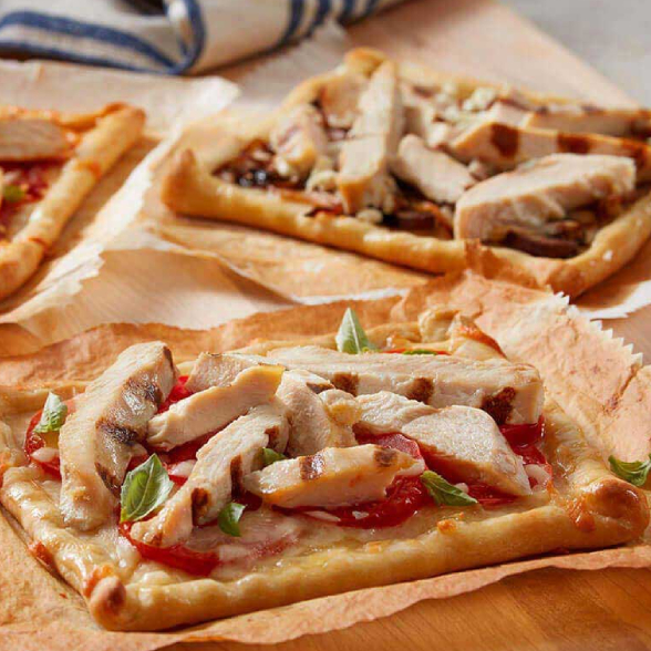 personal pizzas with cooked grilled chicken strips