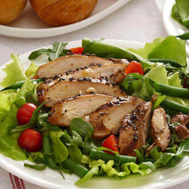 grilled chicken over leafy green salad
